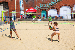 © Licensed to London News Pictures. 12/07/2020. Brighton, UK. Members of the Brighton Beach volleyball club play a game on the court in Brighton And Hove as sunny and warm weather is hitting the seaside resort. Photo credit: Hugo Michiels/LNP