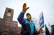 KOHLER, WI — DECEMBER 9, 2015: Jim Bonin waves to a passing car along the picket line outside the Kohler facility, Tuesday, December 8, 2015. Around 2,100 Kohler employees and union members are currently maintaining a 24/7 picket line outside the plant.