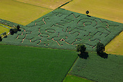 Nederland, Gelderland, gemeente Barneveld, 30-06-2011;.Voorthuizen, maisdoolhof; de tekst 'west is zinloos' heeft betrekking op protest tegen de voorgenomen aanleg van een rondweg. A maze in de cornfield in the city of Voorthuizen, formed by a protesting text against a ringroad..luchtfoto (toeslag), aerial photo (additional fee required).copyright foto/photo Siebe Swart