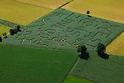 Nederland, Gelderland, gemeente Barneveld, 30-06-2011;.Voorthuizen, maisdoolhof; de tekst 'west is zinloos' heeft betrekking op protest tegen de voorgenomen aanleg van een rondweg. A maze in de cornfield in the city of Voorthuizen, formed by a protesting text against a ringroad..luchtfoto (toeslag), aerial photo (additional fee required).copyright foto/photo Siebe Swart