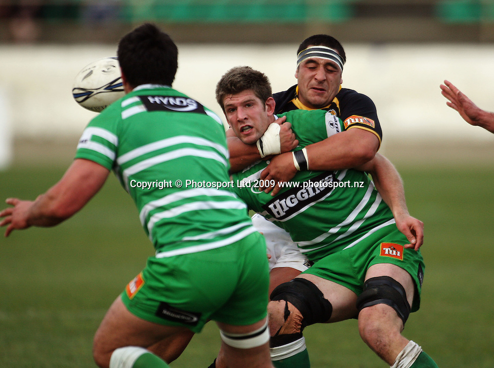 Manawatu lock Mike Fitzgerald passes to Francis Bryant in the tackle of Arden David-Perrot.<br /> Air NZ Cup preseason - Manawatu Turbos v Wellington Lions at FMG Stadium, Palmerston North, New Zealand, Friday 17 July 2009. Photo: Dave Lintott/PHOTOSPORT