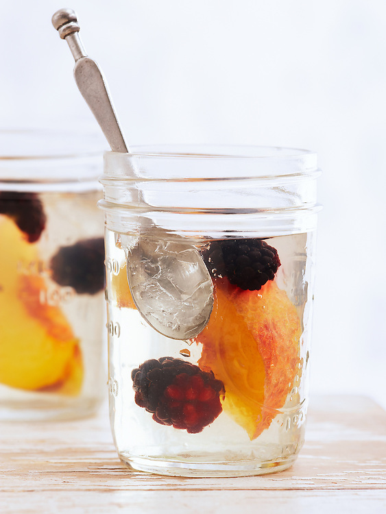 Moonshine gelées with peaches and blackberries.  Made with Midnight Moon Moonshine.