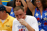 NEW YORK, NY-06 JUL04-- American favourite and second-placer Joey Chestnut showcases his technique during the frenzy of gurgitation that is competitive hot dog eating. (Extra) The Gazette/Liam Maloney