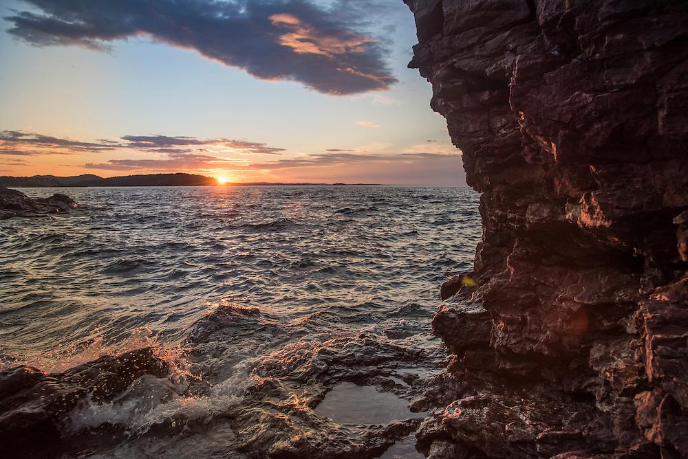 Sunset over Lake Superior at Presque Isle Park, Marquette, Michigan.