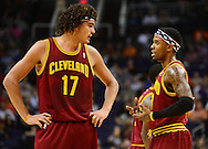 Nov. 09, 2012; Phoenix, AZ, USA; Cleveland Cavaliers center Anderson Varejao (17) talks with teammate guard Daniel Gibson (1) on the court while playing against the Phoenix Suns during the first half at US Airways Center. Mandatory Credit: Jennifer Stewart-US PRESSWIRE.