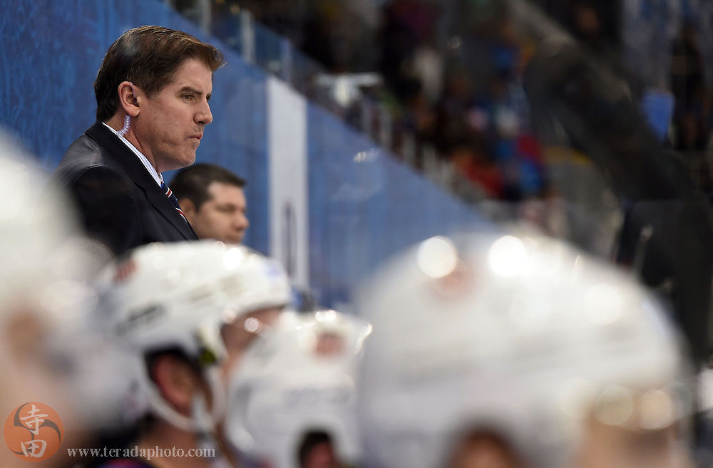 Feb 16, 2014; Sochi, RUSSIA; USA assistant coach Peter Laviolette in a men's ice hockey preliminary round game against Slovenia during the Sochi 2014 Olympic Winter Games at Shayba Arena.