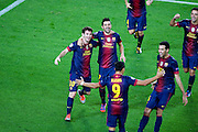 Lionel Messi celebrates scoring the winning goal with his team mates during the Group G UEFA Champions League match between FC Barcelona and Spartak Moscow at the Nou Camp, Barcelona, Spain 19th September 2012. Credit - Eoin Mundow/Cleva Media