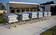 Caskets before being placed inside a tomb for unidentified Katrina Victims  at Charity Hospital Cemetery during a Hurricane Katrina Memorial, in New Orleans on Aug 29, 2008.