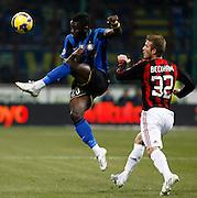 "Sulley Muntari (Inter) David Beckham (Milan).Milano 15/2/2009 Stadio ""Giuseppe Meazza"".Campionato Italiano Serie A.Inter Milan."
