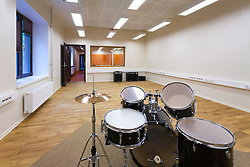 Practice room in H. Eller music school in Tartu, Estonia. Empty classroom with drums. College.