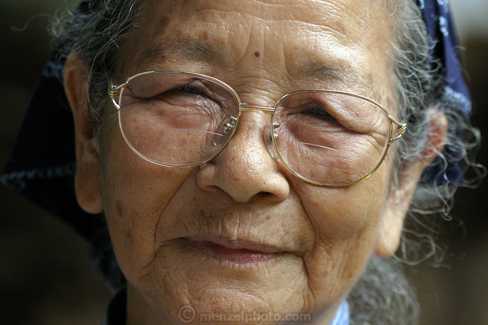 Toshiko Taira, 87, of Kijoka, Okinawa, Japan. Many Okinawans used to work into their nineties, farming, and weaving bashofu, a fine fabric made from a local banana fiber. Bashofu weaving was a home-based craft, and highly valued, but there are few, if any, weavers producing the fabric at home anymore. The workshop of Toshiko Taira, 87, and her daughter, in the northern Okinawa village of Kijoka, is virtually all that is left of the art. She has been named a national treasure of Japan. She and her daughter are attempting to keep the fine practice alive. Although older generations of Okinawans are still living into their one-hundredth year, some say that the decline of weaving in the home was the beginning of the decline of the lengthy life spans of Okinawans.
