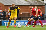 Ashley Chambers of Kidderminster Harriers (10) looks to pass the ball with Joe Tait of York City (5) nearby during the Vanarama National League match between York City and Kidderminster Harriers at Bootham Crescent, York, England on 15 September 2018.