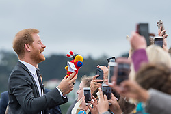 The Duke of Sussex is given a Buzzy Bee soft toy during a public walkabout on a visit to the newly unveiled UK war memorial and Pukeahu National War Memorial Park, in Wellington, on day one of the royal couple's tour of New Zealand.