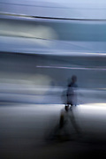 abstract motion blur of one person walking