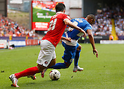 Tjaronn Chery gets past Morgan Fox despite having his shirt pulled during the Sky Bet Championship match between Charlton Athletic and Queens Park Rangers at The Valley, London, England on 8 August 2015. Photo by Andy Walter.