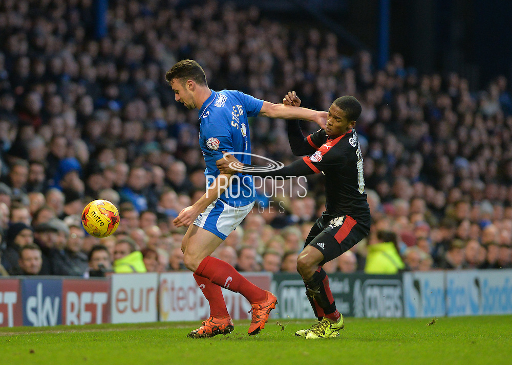 Portsmouth defender Enda Stevens holds off Crawley Town Striker Lewis Young during the Sky Bet League 2 match between Portsmouth and Crawley Town at Fratton Park, Portsmouth, England on 2 January 2016. Photo by Adam Rivers.