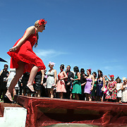 A lady takes the stage during Fashions in the Field during a day at the Races at Ascot Park, Invercargill, Southland, New Zealand. 10th December 2011. Photo Tim Clayton