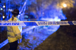 © Licensed to London News Pictures . 02/12/2013 . Bramhall , Stockport , UK . A PCSO guards the scene . Police and forensic scenes of crime investigators work at the scene where the dead body of a teenaged boy was pulled from a pond off Brent Moor Road , today (2nd December 2013) . Photo credit : Joel Goodman/LNP