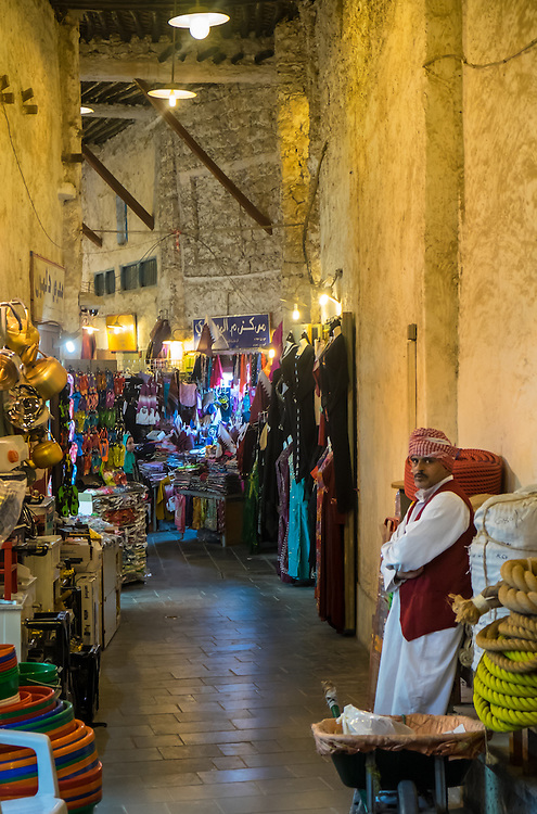 DOHA, QATAR - CIRCA DECEMBER 2013: Merchant at the Souq Waqif. This is a popular and traditional market bazaar in Doha.