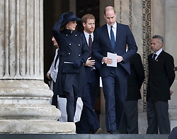 © Licensed to London News Pictures. 14/12/2017. London, UK. Prince Harry walks with The Duke and Duchess of Cambridge from St Paul's Cathedral after attending the Grenfell Tower National Memorial Service mark the six month anniversary of the fire. The service was attended by survivors and relatives of those who lost their lives in the fire, as well as members of the emergency services and members of the Royal family. 71 people were killed when a huge fire ripped though 24-storey Grenfell Tower block in west London in June 2017. Photo credit: Peter Macdiarmid/LNP