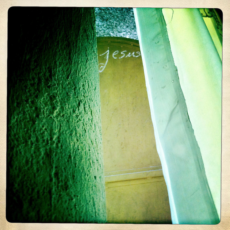 Jesus is written on a wall at a family's home on Tuesday, April 3, 2012 in Kenscoff, Haiti.