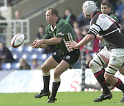 Sport - Rugby 27/04/2002 Parker Pen Shield - Semi-Final.London Irish vs Pontypridd - Kassam Stadium - Oxford.Exiles Brendan Venter moves the ball along the line...[Mandatory Credit, Peter Spurier/ Intersport Images].