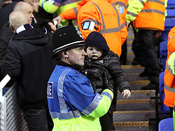 A policeman helps a small child get away from the crowd trouble in the West Bromwich Albion end of the ground - Mandatory byline: Robbie Stephenson/JMP - 20/02/2016 - FOOTBALL - Madejski Stadium - Reading, England - Reading v West Bromwich Albion - FA Cup Fifth Round
