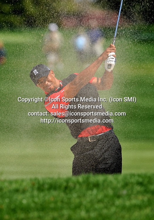 25 March 2013: Tiger Woods in the sand trap on 16th fairway during the final round of the Arnold Palmer Invitational at Arnold Palmer's Bay Hill Club & Lodge in Orlando, Florida.