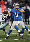 Detroit Lions quarterback Matthew Stafford (9) throws a pass during the NFL week 18 NFC Wild Card postseason football game against the Dallas Cowboys on Sunday, Jan. 4, 2015 in Arlington, Texas. The Cowboys won the game 24-20. ©Paul Anthony Spinelli
