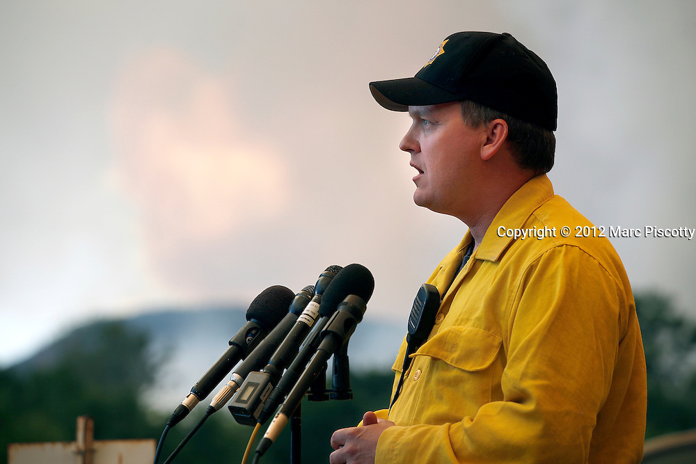 Larimer County Sheriff Justin Smith updates members of the media on firefighting efforts on the High Park Fire near Laporte, Co. on June 10, 2012. The fire started on Saturday and was estimated at more than 14,000 acres on Sunday morning. At least 18 structures were lost or damaged due to the fire with more threatened and officials are searching for one person believed to be missing. The cause of the fire is unknown and it remains at zero percent containment. (Photo by Marc Piscotty / © 2012)