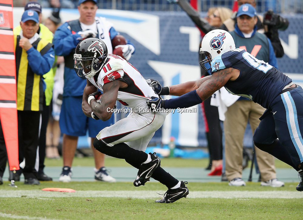 Atlanta Falcons wide receiver Julio Jones (11) breaks away from Tennessee Titans linebacker Derrick Morgan (91) as he scores a third quarter touchdown that gives the Falcons a 10-7 lead during the 2015 week 7 regular season NFL football game against the Tennessee Titans on Sunday, Oct. 25, 2015 in Nashville, Tenn. The Falcons won the game 10-7. (©Paul Anthony Spinelli)
