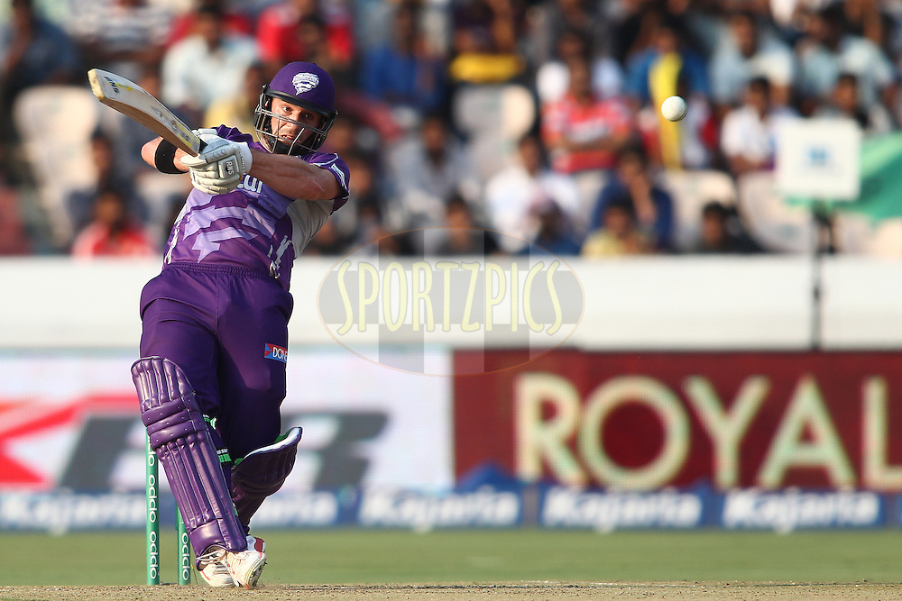 Travis Birt of the Hobart Hurricanes pulls a delivery past the bowler during the first semi final match of the Oppo Champions League Twenty20 between the Kolkata Knight Riders and the Hobart Hurricanes held at the Rajiv Gandhi Cricket Stadium, Hyderabad, India on the 2nd October 2014<br /> <br /> Photo by:  Shaun Roy / Sportzpics/ CLT20<br /> <br /> <br /> Image use is subject to the terms and conditions as laid out by the BCCI/ CLT20.  The terms and conditions can be downloaded here:<br /> <br /> http://sportzpics.photoshelter.com/gallery/CLT20-Image-Terms-and-Conditions-2014/G0000IfNJn535VPU/C0000QhhKadWcjYs