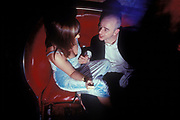 A man chatting up a woman in a bar, club. UK 1990's