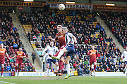 Bradford City defender Nathan Clarke (5) beats Millwall FC forward Steve Morison (20)  to the header  during the Sky Bet League 1 match between Bradford City and Millwall at the Coral Windows Stadium, Bradford, England on 26 March 2016. Photo by Simon Davies.