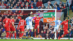 LIVERPOOL, ENGLAND - Sunday, March 8, 2015: Liverpool's Adam Lallana makes a save against Blackburn Rovers during the FA Cup 6th Round Quarter-Final match at Anfield. (Pic by David Rawcliffe/Propaganda)