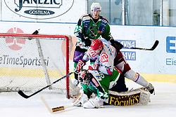 Mike Bayrack (HK Acroni Jesenice, #79) lying on Jan Chabera (HDD Tilia Olimpija, #32) during ice-hockey match between HDD Tilia Olimpija and HK Acroni Jesenice in second game of Final at Slovenian National League, on April 3, 2011 at Hala Tivoli, Ljubljana, Slovenia. (Photo By Matic Klansek Velej / Sportida.com)