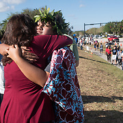 Well wishers place mementos and mourn the day when students and parents came for campus orientation at the Marjory Stoneman Douglas high school for reopening following last week's mass shooting in Parkland, Florida, U.S., February 25, 2018. Attendance was voluntary but hundreds of students and parents showed up. The school opens this coming Wednesday. Seventeen persons including students and staff were murdered in the shooting. REUTERS/Angel Valentin