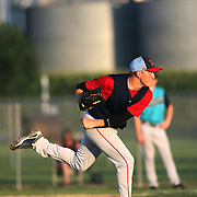 With silos and tall cornfields as a backdrop, Clarinda A's starting pitcher Mark Trentacosta delivers a pitch in the 2010 N.B.C. Central USA Regional Tournament held at Municipal Stadium in Clarinda, Iowa.  photo by David Peterson