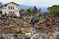 November 1, 2018 - Palu, Central Sulawesi, Indonesia - People collect used goods and iron from homes affected by liquefaction in Petobo, Palu,  32 days after quake-tsunami hit. A deadly earthquake measuring 7.5 magnitude and the tsunami wave caused by it has destroyed the city of Palu and much of the area in Central Sulawesi. According to officials, the death toll from the devastating quake and tsunami has risen to 2088, around 5000 people in hospitals are seriously injured and some 62,000 people have been displaced. (Credit Image: © Risa Krisadhi/Pacific Press via ZUMA Wire)
