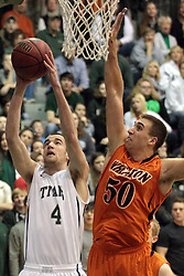 01 March 2014:  Nate Haynes moves in to attempt a block on a shot by Brady Zimmer during an NCAA mens division 3 CCIW  Championship basketball game between the Wheaton Thunder and the Illinois Wesleyan Titans in Shirk Center, Bloomington IL