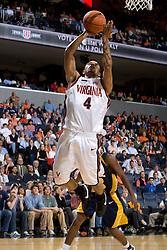 Virginia guard Calvin Baker (4) shoots a layup against Drexel.  The #23 Virginia Cavaliers men's basketball team defeated Drexel Dragons 72-58 at the John Paul Jones Arena in Charlottesville, VA on November 20, 2007.
