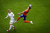 1. divisjon fotball 2018: Aalesund - Åsane (1-0). Aalesunds Holmbert Fridjonsson header i duell med Jonas Hestetun i kampen i 1. divisjon i fotball mellom Aalesund og Åsane på Color Line Stadion.