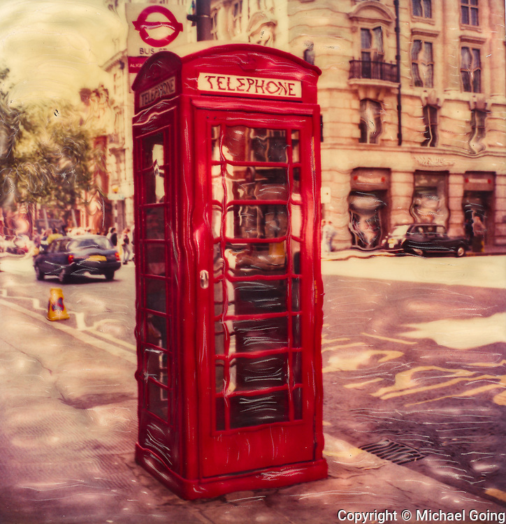 Altered Polaroid of classic red phone booth London, UK