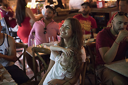 July 1, 2018 - Miami Beach, FL, USA - Yazmine Marimon, 38, and her daughter, Juliette Delauany, 4, watch a soccer match at Tapas and Tintos, a restaurant in Miami Beach, Fla. where fans gathered to watch Spain take on Russia during the 2018 FIFA World Cup Round of 16 knockout stage on Sunday, July 1, 2018. After the score being tied 1-1 at the end of extra time, Russia won, 4 penalty kicks to 3. (Credit Image: © Ellis Rua/TNS via ZUMA Wire)