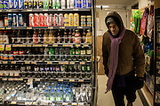 """24 November 2013 - New York, NY [After trading in bottles for their deposit, Austin """"Guy"""" Butler leaves the store.] 11/24/13 Stoneham/CUNY Journalism Photo"""