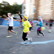 NYTRUN - NOV. 6, 2016 - NEW YORK - Runners turn the corner  back into Central Park from Central Park South at Columbus Circle as they near the end of the 2016 TCS New York City Marathon on Sunday afteroon. NYTCREDIT:  Karsten Moran for The New York Times