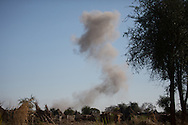 Smoke rises over a villager after a bomb is dropped by an SAF Antanov bomber.