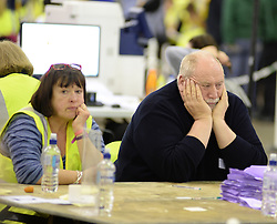Count workers show the signs of a long night at the count in Edinburgh.<br /> © Dave Johnston/ EEm