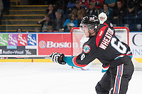 KELOWNA, CANADA - OCTOBER 22: Mitchell Wheaton #6 of the Kelowna Rockets takes a shot against the Calgary Hitmen on October 22, 2013 at Prospera Place in Kelowna, British Columbia, Canada.   (Photo by Marissa Baecker/Shoot the Breeze)  ***  Local Caption  ***