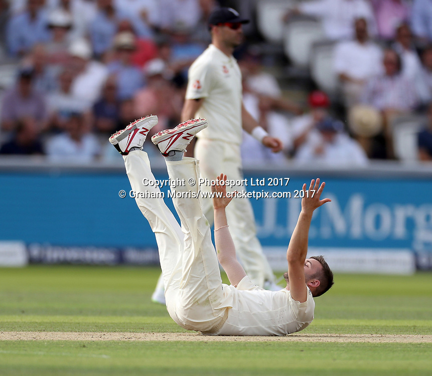 Bowler Mark Wood falls over as he appeals (in vain) for the lbw of Theunis de Bruyn during the 1st Investec Test Match between England and South Africa at Lord's Cricket Ground. Photo: Graham Morris / www.cricketpix.com / www.photosport.nz